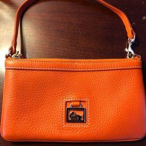 Dooney & Bourke orange clutch.